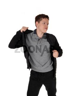 Teenage boy talking of his jacket