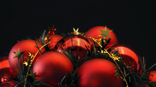 Red Christmas balls on a black background