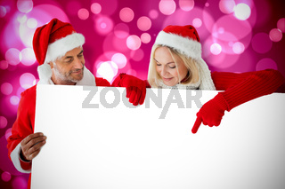 Composite image of festive couple