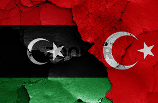flags of Libya and Turkey painted on cracked wall