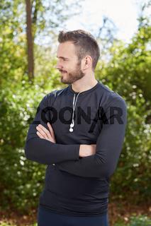 Handsome sporty man  tired runner resting after evening jog, fit