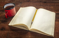 old blank notebook and tea on a rustic table
