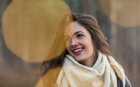 Happy young woman in white scarf