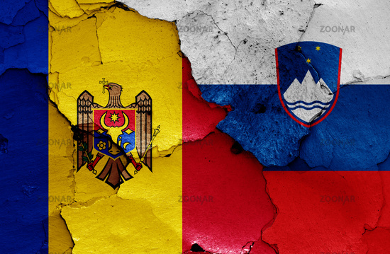 flags of Moldova and Slovenia painted on cracked wall