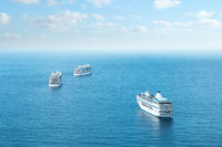 Many cruise ships on ocean, aerial