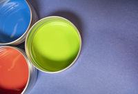 Red Green and Blue Paint Cans on Purple Background