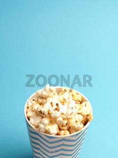 Fresh popcorn on a blue background