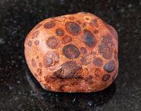 polished Bauxite rock on black
