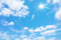 blue sky with sun and clouds background