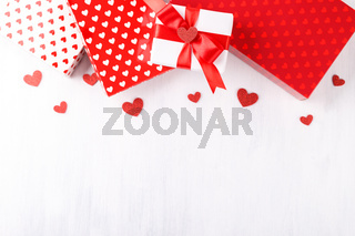 Red and white gift boxes with hearts