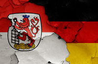 flags of Wuppertal and Germany painted on cracked wall
