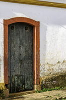 Old wooden door in a house with colonial architecture