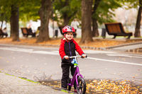 Portrait of a little boy siting on balance bike