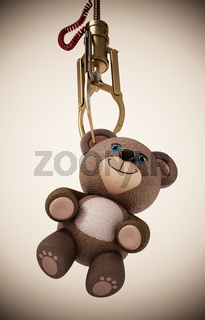 Toy claw machine holding a teddy bear. 3D illustration