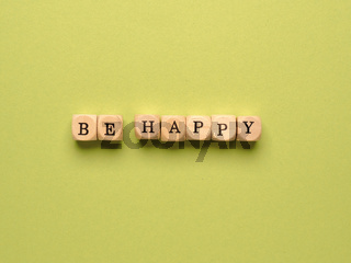 Be happy written with small wooden blocks