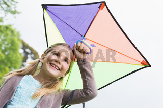 Low angle view of a cute girl with a kite