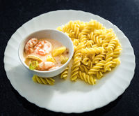 Seafood pasta in sweet and sour sauce