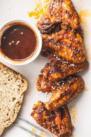 Grilled chicken wings with BBQ sauce.