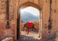Indian man on the elephant and indian woman working in Amber Fort, Jaipur, India