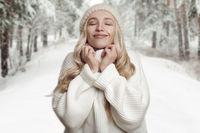 Woman enjoying her winter knitted sweater