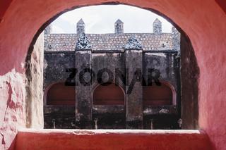 View through arch int the former monestary Convent de San Bernardino de Siena in Valladolid, Yucatan, Mexico