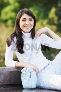 Smiling woman with a blue bag