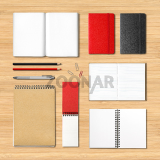 stationery books and notebooks on a wooden background