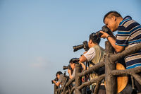 Group of photographers waiting for perfect light