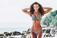 Girl in bikini at seaside