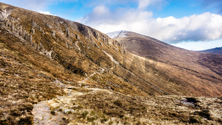 Footpath leading to snow capped peak of Slieve Donard mountain.