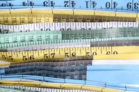 Measuring tape. Top view of measuring tape set close up