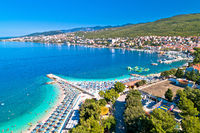Tourist town of Selce and Poli Mora turquoise beach aerial view