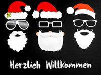 Three Santa Claus Paper Mask, Black Background, Herzlich Willkommen Mean Welcome
