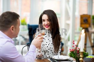 Cheerful couple during festive Christmas dinner