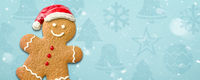 Christmas background with a gingerbread man and copy space