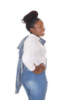 Beautiful African woman standing in jeans in the studio