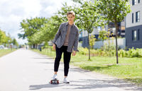 teenage boy on skateboard on city street
