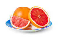 Ripe grapefruits on blue plate