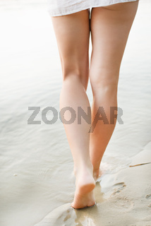 Beach travel - woman walking