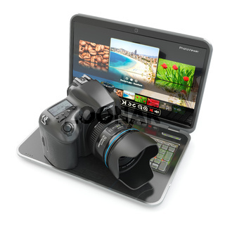Digital photo camera and laptop. Journalist  or  traveler equipment.