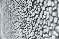 Mauer oder Wand mit vielen grauen Kiesel Steinen