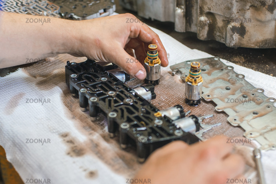 repair of parts of an automatic transmission of a car with a shallow depth of field