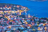 Amazing town of Hvar waterfront aerial evening view