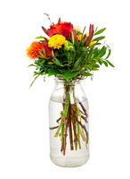 Isolated flower arrangement in a glass vase