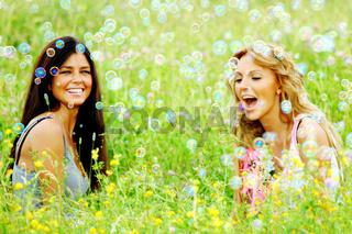 Girlfriends on summer grass