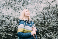 Authentic smiling blonde woman. Retro analog vintage swirley bokeh film look. Real middle aged people concept.