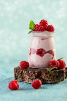 Berry yogurt with fresh raspberries and mint.