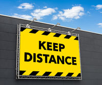 Keep distance written on a billboard