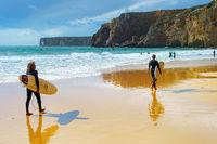 Surfing men surfboard Algarve Portugal