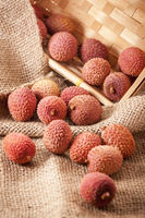 Basket with lychees on sackcloth